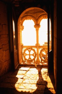 Light pouring through a gothic archway & window